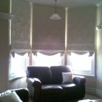 Swagged base roman blinds
