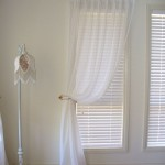 timber shutters and goblet sheers